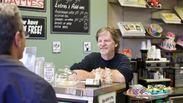 Jack Phillips - behind counter, smiling